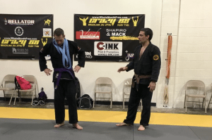 BJJ Coach Keith Cebula with new Purple Belt Jeff Mueller