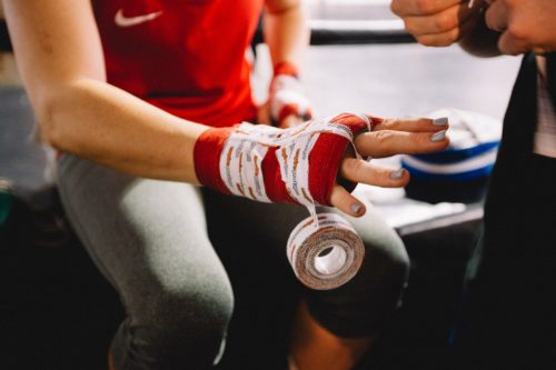 Female boxer getting ready to fight - dylan-nolte-588372-unsplash